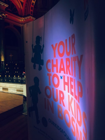 """Your Charity to Help Our Kids in Bosnia"". Promotional banner at Our Kids Foundation fundraising concert."