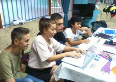 Children using laptops for homework at Children's Home Mostar. Laptops donated by HERO World Support.