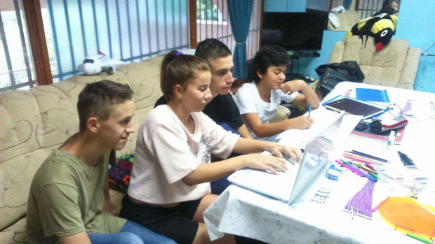 Children using laptops for homework at Children's Home Mostar. Laptops donated by HERO World Support.