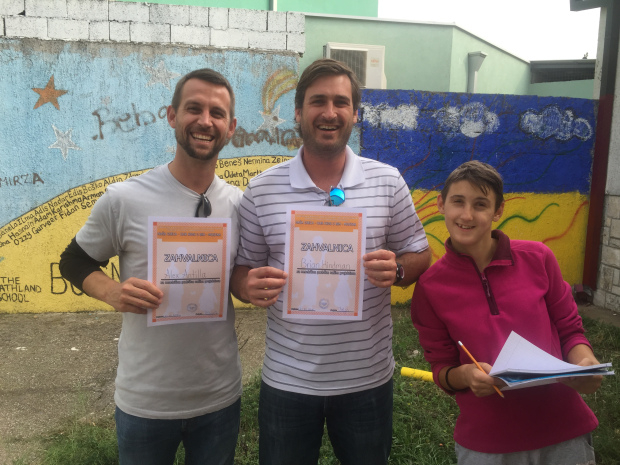 Alex and Brian from HERO World Support with certificate of thanks for laptop donations.