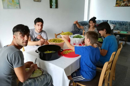Beneficiaries of Our Kids Foundation Residential Program preparing a meal.
