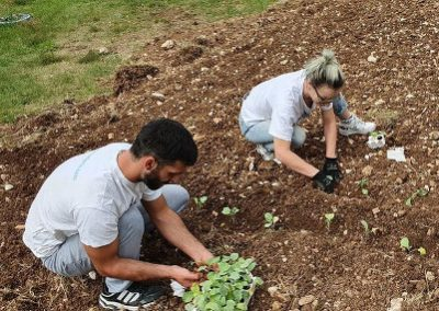 Beneficiaries of Our Kids Foundation Residential Program planting vegetables at the home.